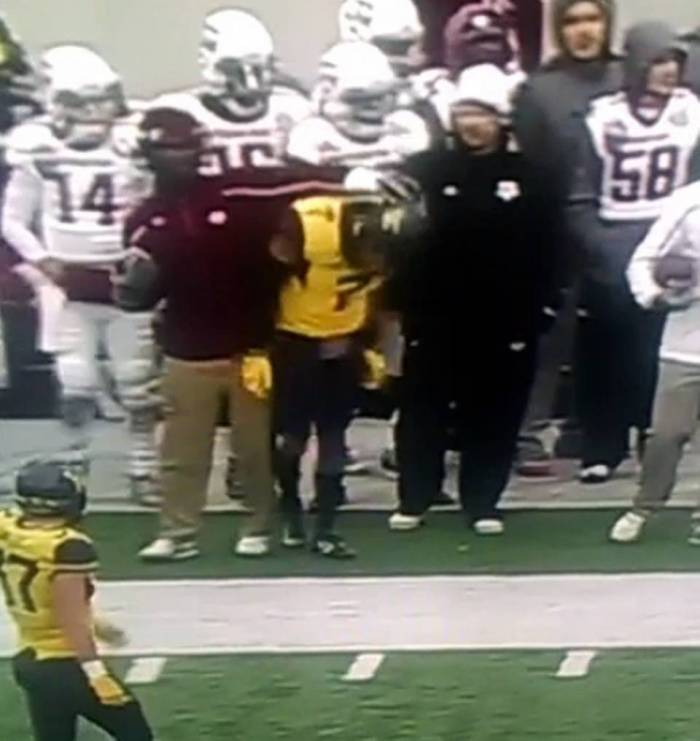Texas A&M student assistant, Mike Richardson, shoves West Virginia's cornerback, Daryl Worley, during the AutoZone Liberty Bowl.